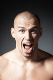 Portrait of screaming man isolated on gray stock images