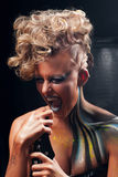 Portrait of screaming punk woman with body art Royalty Free Stock Photography