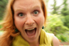 Portrait of screaming redhead girl Stock Images