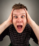 Portrait of screaming surprised man Stock Photos