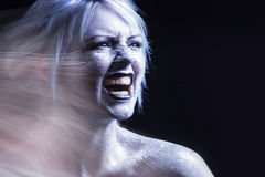 Portrait screaming woman. Bright neon fashion makeup, creative body art. Effect of movement. Young woman sticking tongue out. Bright neon fashion makeup Stock Images