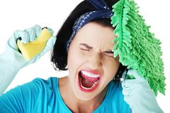Portrait of screaming woman with a mop and sponge Stock Photo