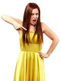Portrait of a screaming woman in yellow dress Stock Image