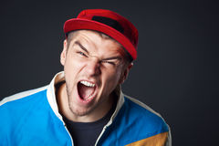 Portrait of screaming young guy in studio. Royalty Free Stock Images