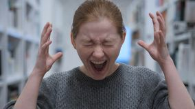 Portrait of Screaming Young Woman, Shouting in Cafe stock photo