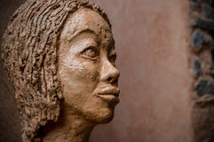 Portrait of a sculpture woman Stock Photos