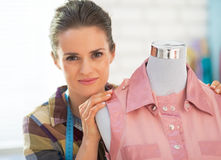 Portrait of seamstress near mannequin Royalty Free Stock Images