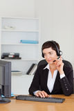 Portrait of a secretary calling with a headset Stock Image