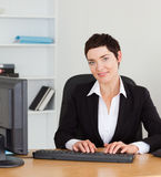 Portrait of a secretary typing on her keybord Stock Images