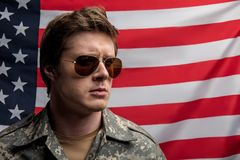 Earnest young officer protecting his country royalty free stock images