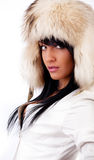 Portrait of seductive brunette staring. Playful look of sexy girl  wearing fur hat Royalty Free Stock Photo