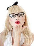 Portrait of seductive businesswoman. Portrait of seductive businesswoman wearing glasses on white background. Woman makes kissing lips Royalty Free Stock Photo