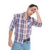 Portrait of seductive smart casual man fixing his hair stock images
