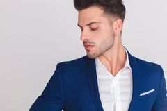 Portrait of seductive smart casual man looking down to side royalty free stock images