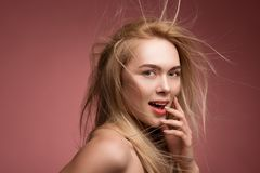 Coquettish lady with chaotic hairstyling royalty free stock image