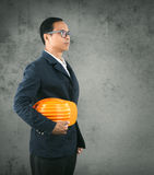 Portrait of self conficence engineering man holding safety helme Royalty Free Stock Photography