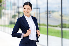 Portrait of self confidence business woman. Next to the office royalty free stock image