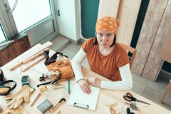 Portrait of self employed female carpenter in her woodwork workshop royalty free stock photography