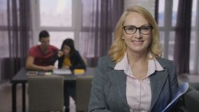 Portrait of senior adult real-estate agent smiling stock video