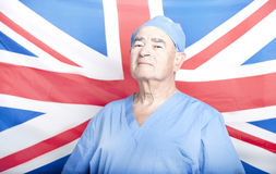 Portrait of a Senior Adult Surgeon in front of a British Flag Stock Images