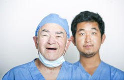 A portrait of Senior adult surgeon and a young Asian doctor Royalty Free Stock Photography