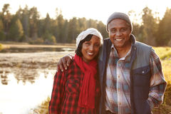 Portrait Of Senior African American Couple Walking By Lake Stock Photo