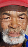 Portrait of an senior African man. Close up of the face of a wrinkled face of an African man royalty free stock images