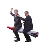 Portrait of senior asian business man playing riding on rocket h Royalty Free Stock Images