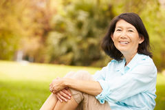 Portrait Of Senior Asian Woman Sitting In Park Stock Images