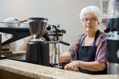 Portrait of Senior Barista Preparing Coffee Royalty Free Stock Photography