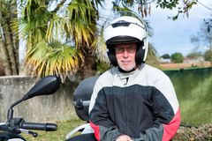 Portrait of a senior biker on his motorcycle Royalty Free Stock Image