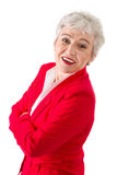Portrait of a senior business woman isolated on white. Portrait of a senior business woman in a red blazer isolated on white Royalty Free Stock Images