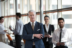 Portrait of senior businessman as leader  with group of people i Stock Photography