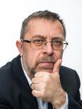Portrait of senior businessman in a black jacket Stock Photo