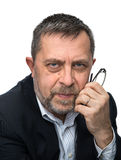 Portrait of senior businessman in a black jacket Stock Images