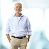 Portrait Of A Senior Businessman Smiling. In his office Stock Photography