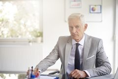 Financial advisor businessman working in the office stock photography