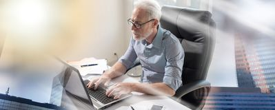 Portrait of senior businessman working on laptop, hard light; multiple exposure royalty free stock photos