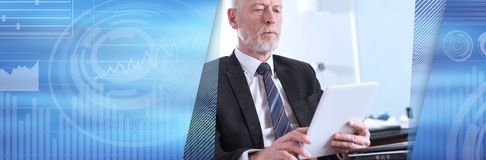 Portrait of senior businessman working on tablet. panoramic banner stock photo