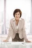 Portrait of senior businesswoman in office Stock Images