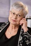 Portrait of senior businesswoman with phone Stock Photo