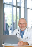 Portrait of a senior caring doctor Stock Image