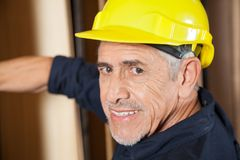 Portrait Of Senior Carpenter Smiling Royalty Free Stock Photo