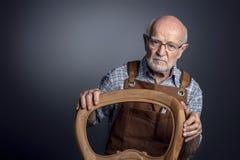 Portrait of senior caucasian craftsman royalty free stock image