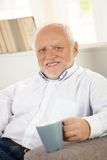 Portrait of senior with coffee mug Royalty Free Stock Photos