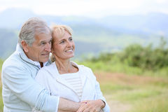 Portrait of senior couple in countryside. Portrait of senior couple looking towards the future Royalty Free Stock Image