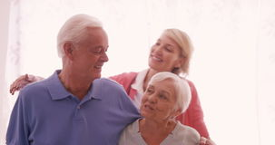 Portrait of senior couple and doctor smiling stock footage