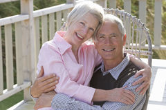 Portrait of senior couple embracing stock photos