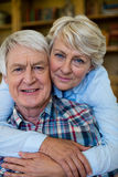 Portrait of senior couple embracing each other Stock Image