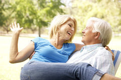 Portrait Of Senior Couple Enjoying Day In Park Royalty Free Stock Image